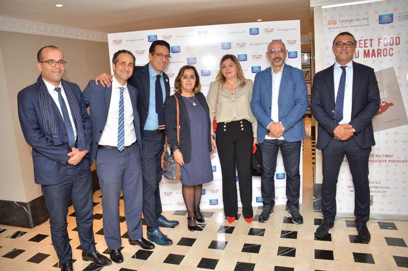 Bouchra Outaghani et Rafik Lahlou entouré de l'équipe Cosumar présente à cet événement